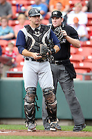 Charlotte Knights catcher Donny Lucy #4 in the field with umpire Chris Conroy during a game against the Buffalo Bisons at Dunn Tire Park on May 22, 2011 in Buffalo, New York.  Buffalo defeated Charlotte by the score of 7-5.  Photo By Mike Janes/Four Seam Images