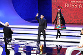 1st December 2017, State Kremlin Palace, Moscow, Russia;  Retired player and draw assistant Diego Maradona (C) arrives onstage during the FIFA 2018 World Cup draw, at the State Kremlin Palace in Moscow, Russia, 01 December 2017.