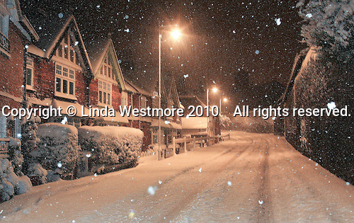 Snow  falling at night, Petworth, Sussex.  The camera's flash has frozen the individual snowflakes.