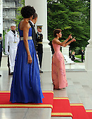United States  President Barack Obama and First Lady Michelle Obama look on as Chief of Protocol of the United States Capricia Penavic Marshall gets up after slipping as they wait to welcome Mexican President Felipe Calderon and Mexican First Lady Margarita Zavala on the North Portico of the White House for a State Dinner in Washington on Wednesday, May 19, 2010.  .Credit: Roger L. Wollenberg - Pool via CNP