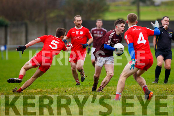 Dromids Cian Ó Sé with the hard work done gets blown up for an over carry.
