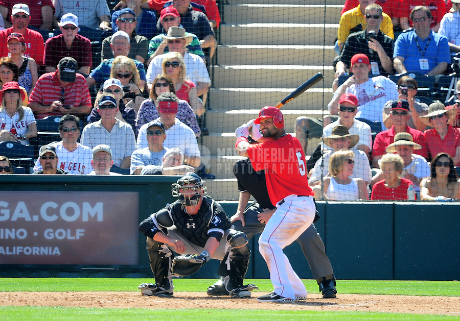 Mar. 6, 2012; Tempe, AZ, USA; Los Angeles Angels outfielder Albert Pujols bats in the second inning against the Chicago White Sox during a spring training game at Tempe Diablo Stadium.  Mandatory Credit: Mark J. Rebilas-