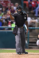 Umpire Christopher Lloyd makes a call during a game between the Quad Cities River Bandits and Kane County Cougars on August 14, 2014 at Third Bank Ballpark in Geneva, Illinois.  Kane County defeated Quad Cities 4-1.  (Mike Janes/Four Seam Images)