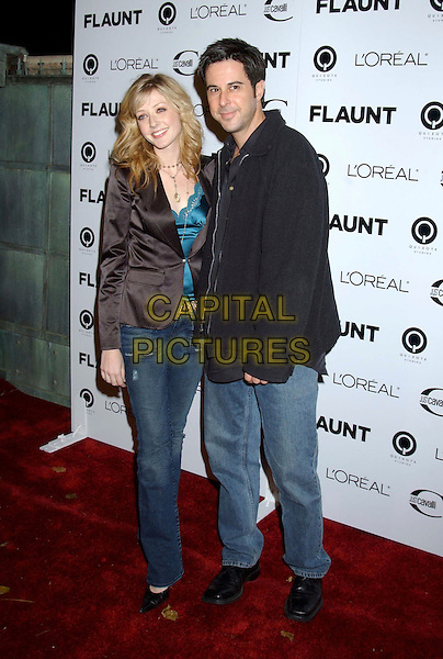 """JENNIFER FINNIGAN & JONATHAN SILVERMAN .During """"Just Cavalli"""" Flaunt Magazine's 6 Year Anniversary Party and Holiday Toy Drive to benefit Para Los Ninos held at a private residence in Los Angeles, California, USA, December 10th 2004..full length.Ref: ADM.www.capitalpictures.com.sales@capitalpictures.com.©Laura Farr/AdMedia/Capital Pictures ."""