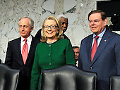 "United States Secretary of State Hillary Rodham Clinton, center, poses for a photo with Ranking Member Bob Corker (Republican of Tennessee), left, and Chairman Robert Menendez (Democrat of New Jersey), right before giving testimony before the U.S. Senate Committee on Foreign Relations on ""Benghazi: The Attacks and the Lessons Learned"" in Washington, D.C. on Wednesday, January 23, 2013..Credit: Ron Sachs / CNP.(RESTRICTION: NO New York or New Jersey Newspapers or newspapers within a 75 mile radius of New York City)"