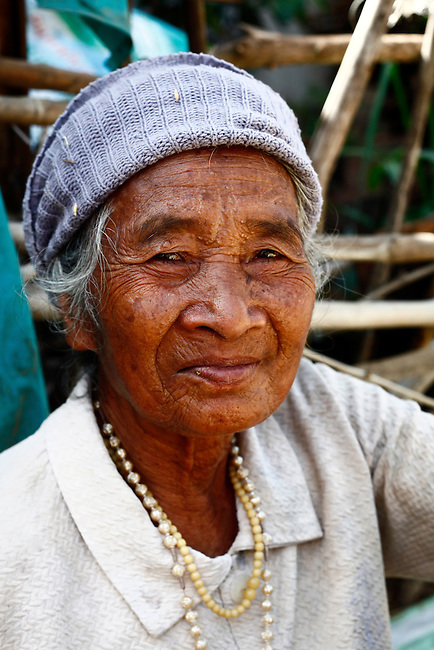 A Bahnar woman sits for a portrait near the Central Highlands town of Kon Tum, Vietnam. The Bahnar are one of more than two dozen hill tribes known formerly in the West as Montagnards, but who are now called the Dega. April 14, 2012.