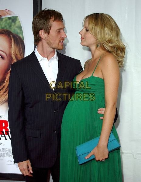 "ALEX DE RAKOFF & MONET MAZUR.At New Line Cinema's Los Angeles Premiere of ""Monster-in-Law"" held at The Mann National Theatre in Westwood, California, USA,.half length pregnant green dress turquoise clutch bag.Ref: DVS.www.capitalpictures.com.sales@capitalpictures.com.©Debbie VanStory/Capital Pictures"