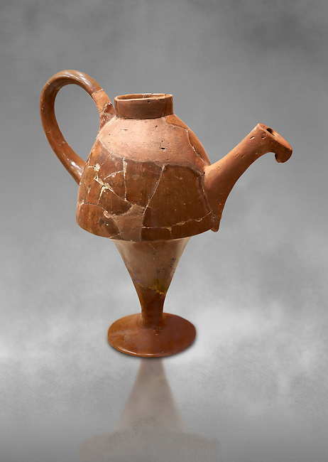 Hittite terra cotta side spouted tapered base teapot. Hittite Empire, Alaca Hoyuk, 1450 - 1200 BC. Alaca Hoyuk. Çorum Archaeological Museum, Corum, Turkey. Against a grey bacground.