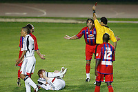 Crystal Palace forward Sergio Flores (11) receives a red card from referee Hilario Grajeda during the 119th minute. The New England Revolution (MLS) defeated Crystal Palace FC USA of Baltimore (USL2) 5-3 in penalty kicks after finishing regulation and overtime tied at 1-1 during a Lamar Hunt US Open Cup quarterfinal match at Veterans Stadium in New Britain, CT, on July 8, 2008.