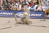 Huntington Beach, CA - 5/6/07:  Stein Metzger dives into the sand for the ball during Lambert / Metzger's 21-17, 21-18 win over Gibb / Rosenthal in the championship match of the AVP Cuervo Gold Crown Huntington Beach Open of the 2007 AVP Crocs Tour..Photo by Carlos Delgado