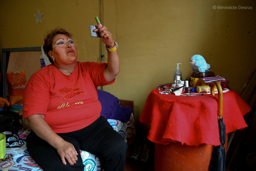Paola, a resident of Casa Xochiquetzal, puts on makeup in her bedroom at the shelter in Mexico City, Mexico on July 1, 2008. Casa Xochiquetzal is a shelter for elderly sex workers in Mexico City. It gives the women refuge, food, health services, a space to learn about their human rights and courses to help them rediscover their self-confidence and deal with traumatic aspects of their lives. Casa Xochiquetzal provides a space to age with dignity for a group of vulnerable women who are often invisible to society at large. It is the only such shelter existing in Latin America. Photo by Bénédicte Desrus