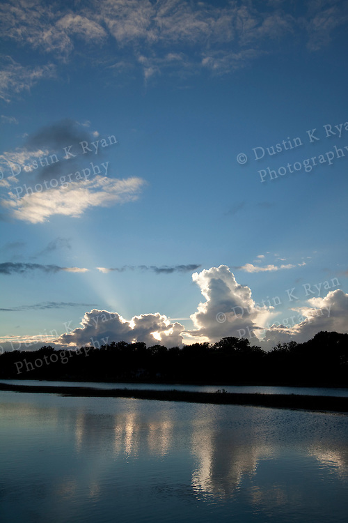 South Carolina Lowcountry sunset dock marsh grass scene HDR sun setting behind clouds escaping light rays