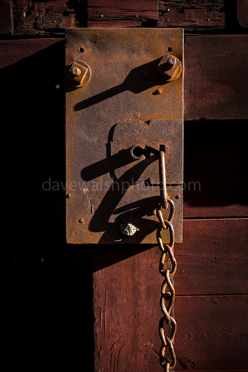Lock and chain at sunset