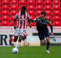 4th July 2020; Bet365 Stadium, Stoke, Staffordshire, England; English Championship Football, Stoke City versus Barnsley; Bruno Martins Indi of Stoke City and Jordan Williams of Barnsley