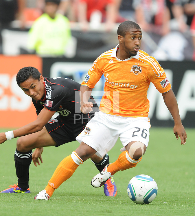 Houston Dynamo defender (26) Corey Ashe shields the ball against DC United midfielder Andy Najar (14)  Houston Dynamo tied DC United 2-2, at RFK Stadium, Saturday June 25, 2011.