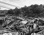 The Collinsville Company suffered heavy damage. This view is of the former grinding and polishing department. The building, set on the river bank, was completely washed away when the Farmington River topped the retaining wall by an estimated 30 feet.