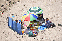 Thursday 25 May 2017<br /> Pictured: A family enjoys a day out on the beach<br /> Re: People enjoy the warm sunshine in Tenby, , West Wales. Temperatures today are expected to reach the high 20s Centigrade in many parts of the UK, making it one of  warmest days of the year so far