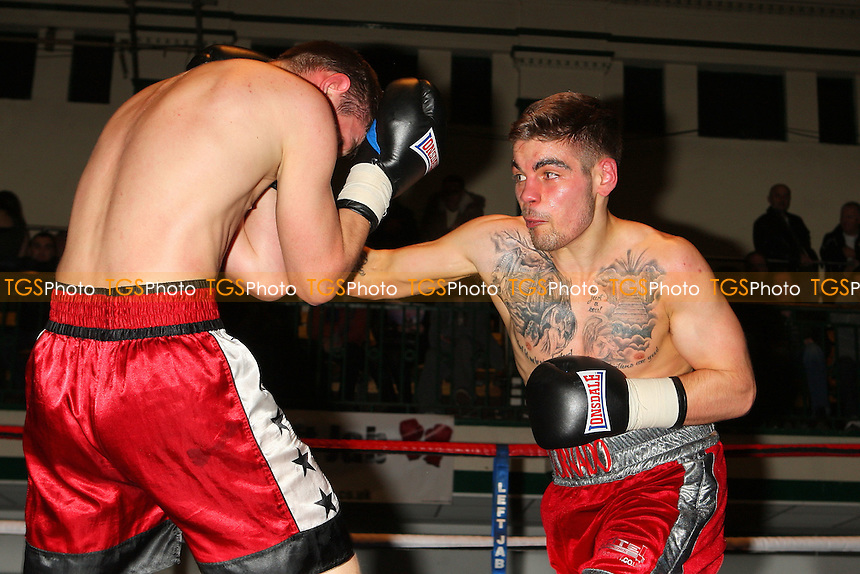 Tyler Goodjohn (red/silver shorts) defeats Jegoras Michaliovas in a Welterweight boxing contest at York Hall, Bethnal Green, promoted by Left Jab - 04/03/11 - MANDATORY CREDIT: Gavin Ellis/TGSPHOTO - Self billing applies where appropriate - 0845 094 6026 - contact@tgsphoto.co.uk - NO UNPAID USE.