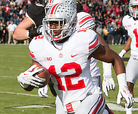 Ohio State defensive back Doran Grant (12) makes a 33-yard interception return for a touchdown. The Ohio State Buckeyes defeated the Purdue Boilermakers 56-0 at Ross-Ade Stadium, West Lafayette, Indiana on November2, 2013.