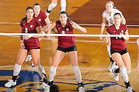 20 November 2008:  UALR middle blocker Lora Dickey (9), flanked by teammates Guiliana De Francesco (3) and Kristi Block (14), await a serve in the New Orleans 3-1 victory over UALR in the first round of the Sun Belt Conference Championship tournament at FIU Stadium in Miami, Florida.
