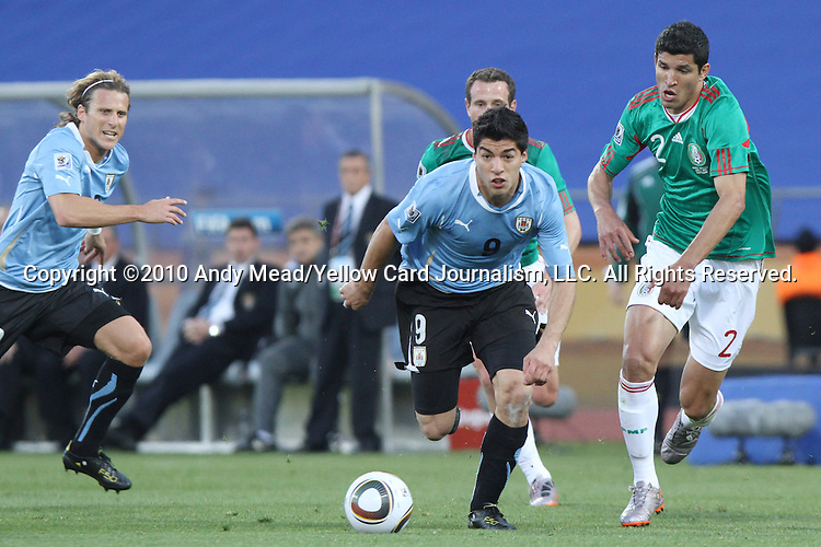 22 JUN 2010: Luis Suarez (URU) (9) and Francisco Rodriguez (MEX) (2). The Uruguay National Team defeated the Mexico National Team 1-0 at Royal Bafokeng Stadium in Rustenburg, South Africa in a 2010 FIFA World Cup Group A match.