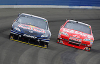 Oct. 11, 2009; Fontana, CA, USA; NASCAR Sprint Cup Series driver Brian Vickers (left) leads Tony Stewart during the Pepsi 500 at Auto Club Speedway. Mandatory Credit: Mark J. Rebilas-