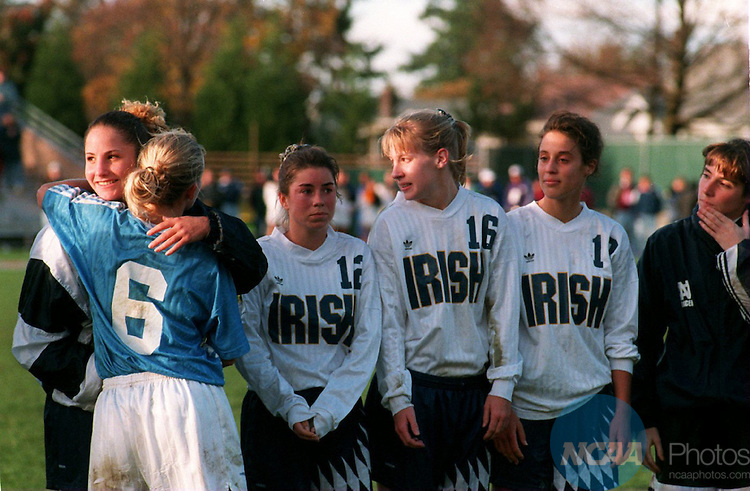 Caption: North Carolina's Angela Kelly congratulates a Notre Dame player on a good game after Carolina defeated Notre Dame 5-0 at the Division I Women's Soccer Championship November 20, 1994, in Portland, Oregon. Jacqueline Koch/NCAA Photos.