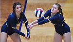 Althoff player Katie Wemhoener (left) is ready to help teammate Mia Orlet handle a Minooka serve. Althoff lost to Minooka in the championship game of the O'Fallon Class 4A volleyball sectional at O'Fallon HS in O'Fallon, IL on November 6, 2019.<br /> Tim Vizer/Special to STLhighschoolsports.com
