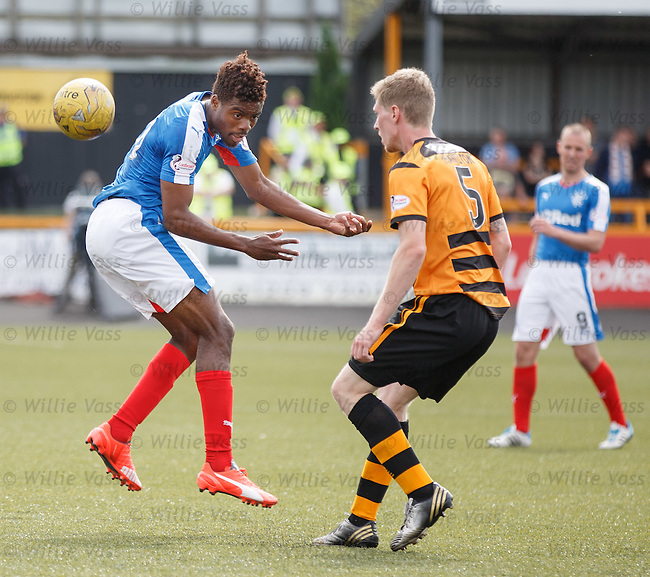 Nathan Oduwa flicks the ball over defender Colin Hamilton and runs away into the box