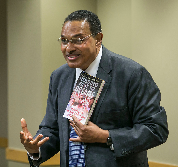 Holding a copy of his latest book, Dr. Freeman Hrabowski, speaks Tuesday, April 18, 2017, at DePaul University as part of the President's Speakers Series on Race and Free Speech. Hrabowski is president of the University of Maryland - Baltimore County, and chair of the President's Advisory Commission on Educational Excellence for African Americans. His research and publications focus on science and math education, with special emphasis on minority participation and performance. (DePaul University/Jamie Moncrief)