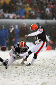 December 16th, 2007:  Cleveland Browns kicker Phil Dawson (4) launches a 49-yard field goal that hit the back of the upright to extend the Browns lead to 5-0 over the Bills as placeholder/punter Dave Zastudil (15) holds the ball at Cleveland Browns Stadium in Cleveland, Ohio.  The Browns shutout the Bills 8-0 to inch closer to a playoff spot.  Photo copyright Mike Janes Photography 2007.