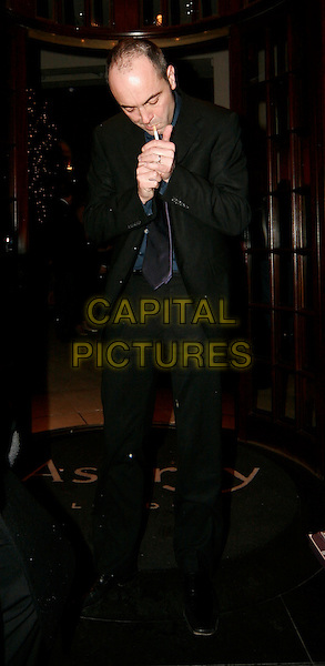 "JAMES NESBITT.""Match Point"" after show party at Asprey, London, UK..December 18th, 2005.Ref: SW.full length lighting cigarette black suit.www.capitalpictures.com.sales@capitalpictures.com.©Capital Pictures."