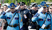 Police Officers attend the National Peace Officers Memorial Service, an annual ceremony honoring law enforcement who were killed in the line of duty in the previous year, at the US Capitol in Washington, DC, May 15, 2015. <br /> Credit: Olivier Douliery / Pool via CNP