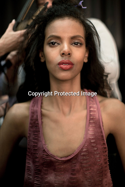 CAPE TOWN, SOUTH AFRICA - JULY 15: A model has her make up and hair done before a fashion show at the the Cape Town Fashion Week on July 15, 2011, in Cape Town, South Africa. Some of South Africa's finest designers showed their 2011 Spring and summer collections during the 3 day event. Photo by Per-Anders Pettersson