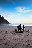 USA, Oregon, Oswald West State Park, individuals hang out on the beach at Oswald State Park, just south of Cannon Beach