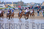 Horses go around the second time at the Ballyheigue Races on Sunday on Ballyheigue Beach.......