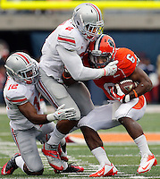 Ohio State Buckeyes linebacker Ryan Shazier (2) tackles Illinois Fighting Illini running back Josh Ferguson (6) with help from Ohio State Buckeyes cornerback Doran Grant (12) during the NCAA football game at Illinois on Saturday, November 16, 2013. (Columbus Dispatch photo by Brooke LaValley)