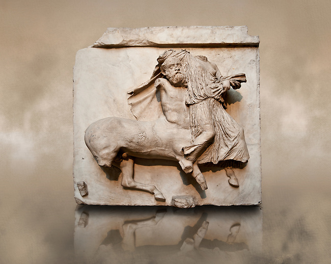 Sculpture of Lapiths and  Centaurs battling from the Metope of the Parthenon on the Acropolis of Athens no XXIX. Also known as the Elgin marbles. British Museum London. A Centaur with pointed ears is carrying off a virgin.