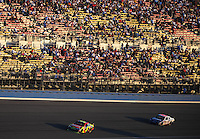 Aug 31, 2008; Fontana, CA, USA; NASCAR Sprint Cup Series drivers Casey Mears (5) leads Patrick Carpentier (10) in front of the main grandstands during the Pepsi 500 at Auto Club Speedway. Mandatory Credit: Mark J. Rebilas-