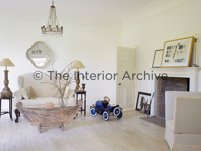 The living room where a restrained palette of white and oatmeal has resulted in a cool and relaxing space
