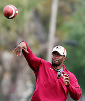 TALLAHASSEE, FLA. 3/26/11-FSU032611 CH-Quarterbacks Coach Dameyune Craig throws to his players during practice Saturday in Tallahassee..COLIN HACKLEY PHOTO