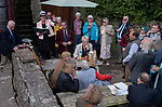 Priddy Friendly Society annual Club Walk Day. Somerset Uk 2019. Members meet at the Queen Victoria, for the roll call. In 2019 there are 146 members, of which 18 are new members. Rhonda Gould club secretary conducting the roll call.President of the Priddy Friendly Society John Dally at her side.