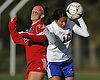Melanie Navas #10 of East Meadow, right, heads a ball away from Natalie Heberer #28 of Syosset during a Nassau County Class AA varsity girls soccer quarterfinal at East Meadow High School on Tuesday, Oct. 25, 2016. Syosset won by a score of 2-1.