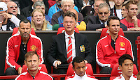 Pictured: Manager Louis Van Gaal (C) and assistant Ryan Giggs (L) .  Saturday 16 August 2014<br />