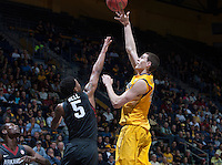 David Kravish of California shoots the ball during 2014 National Invitation Tournament against Arkansas at Haas Pavilion in Berkeley, California on March 24th, 2014.  California defeated Arkansas, 75-64.