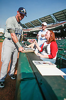 Fans ask for autographs before the MiLB matchup between the New Orleans Zephyrs and the Oklahoma City Redhawks at Chickasaw Bricktown Ballpark on June 10th, 2012 in Oklahoma City, Oklahoma. The Redhawks defeated the Zephyrs 12-9  (William Purnell/Four Seam Images)