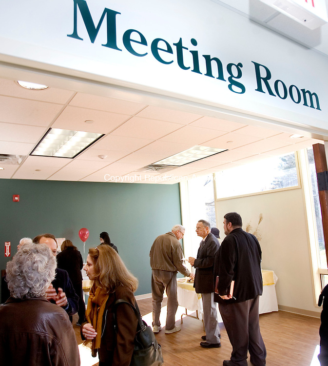 MIDDLEBURY CT. 04 November 2013-110413SV10-Guests check out the new meeting space at the public library in Middlebury Monday. The library had it grand reopening after a long renovation. <br /> Steven Valenti Republican-American