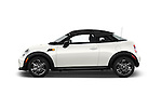 Car Driver side profile view of a 2015 MINI Mini Cooper 2 Door Coupe Side View