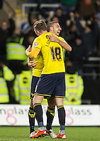 John Lundstram of Oxford United & Liam Sercombe of Oxford United celebrate there victory during the Johnstone's Paint Trophy Southern Final 2nd Leg match between Oxford United and Millwall at the Kassam Stadium, Oxford, England on 2 February 2016. Photo by Andy Rowland / PRiME Media Images.