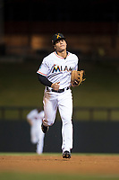 Salt River Rafters shortstop Bryson Brigman (15), of the Miami Marlins organization, jogs off the field between innings of an Arizona Fall League game against the Scottsdale Scorpions at Salt River Fields at Talking Stick on October 11, 2018 in Scottsdale, Arizona. Salt River defeated Scottsdale 7-6. (Zachary Lucy/Four Seam Images)